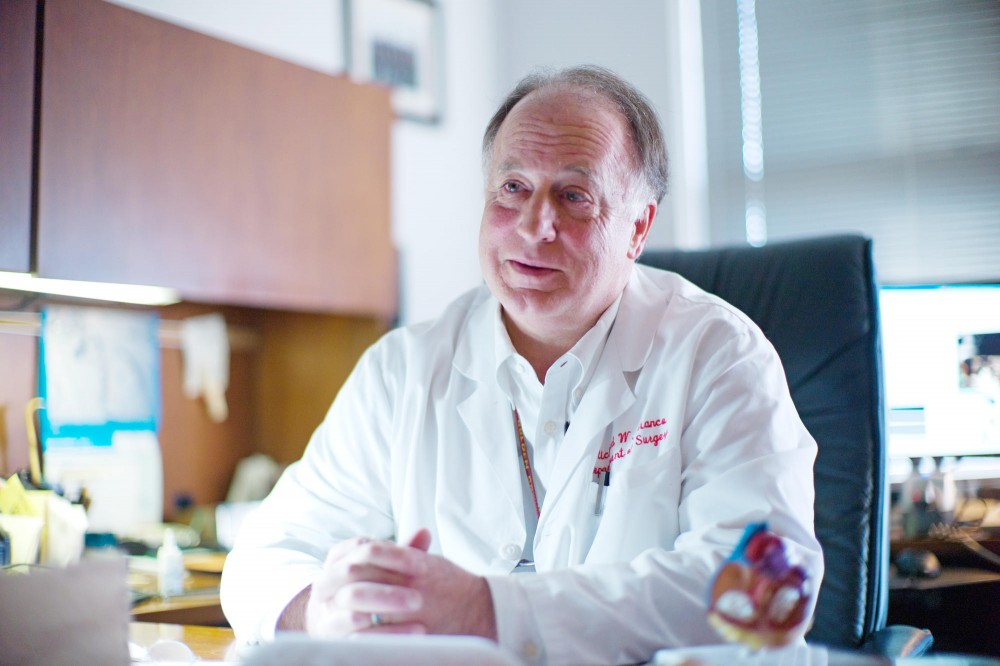 Experimental Surgical Services director Dick Bianco discusses his research in his office Friday at his office.  Bianco tests heart valves in animals before the valves can be used in human trials.