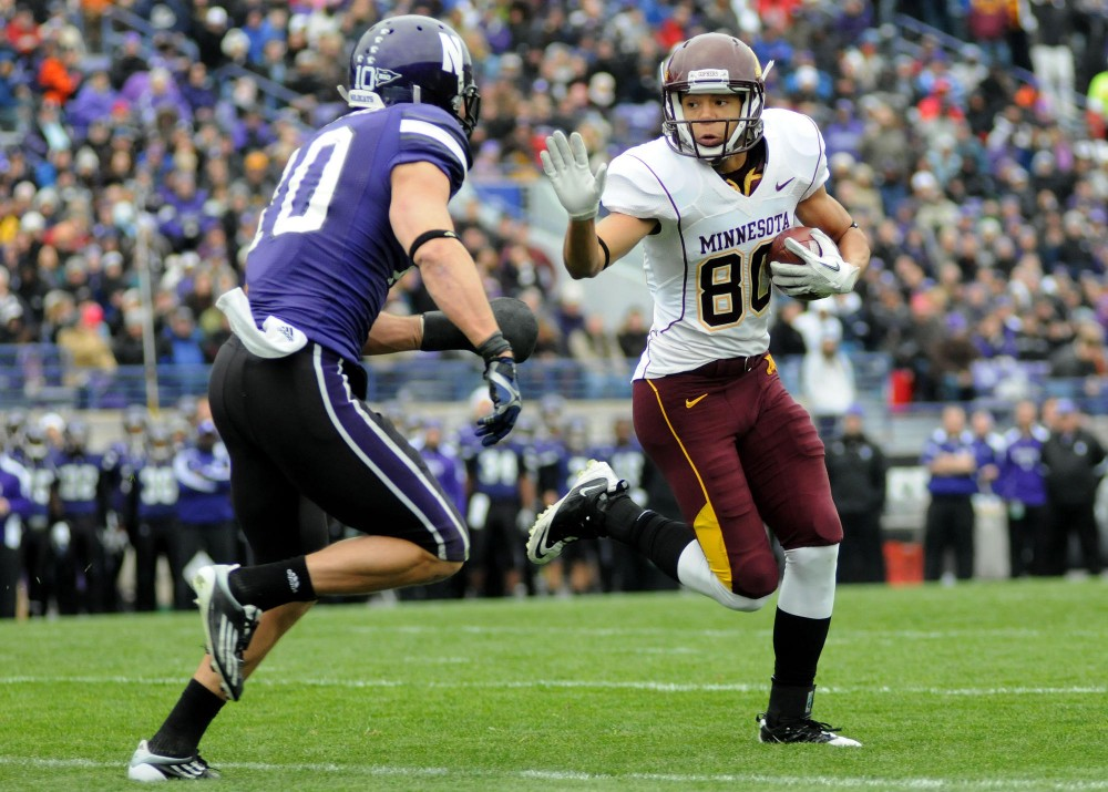 November 19, 2011: Brian Peters #10 of Northwestern goes in to tackle Devin Crawford-Tufts #80 of Minnesota during the NCAA football game between University of Minnesota and Northwestern University at Ryan Field, Evanston, Illinois. (Cal Sport Media via AP Images)
