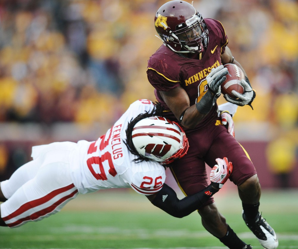 Minnesota wide receiver Da'Jon McKnight gets taken down by Wisconsin defensive back Antonio Fenelus Saturday, November 12 at TCF Bank Stadium.