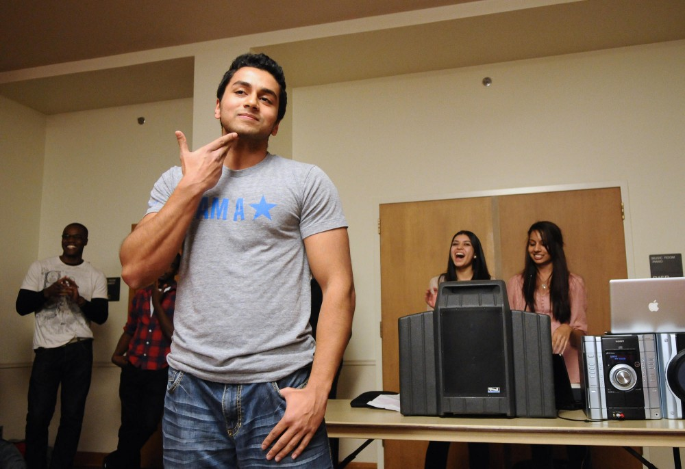 Junior Rezwam Islam goes up for auction during a fundraiser for Feed My Starving Children on Thursday night at Comstock Hall.