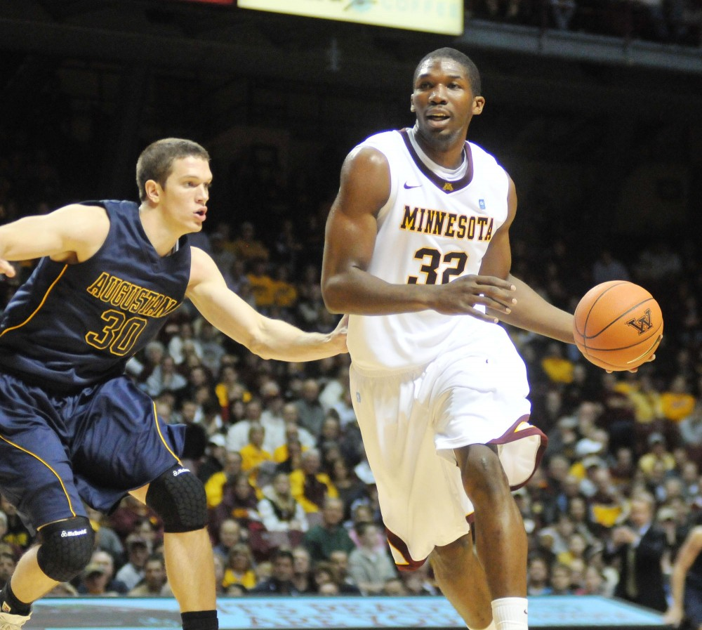 Minnesota forward Trevor Mbakwe charges up the court against Agustana Monday at Williams Arena.