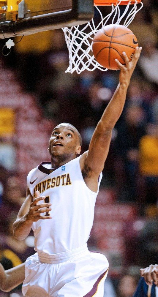 Gophers' guard Andre Hollins goes for a layup during a game against Mount St. Marys on Monday at Williams Arena.