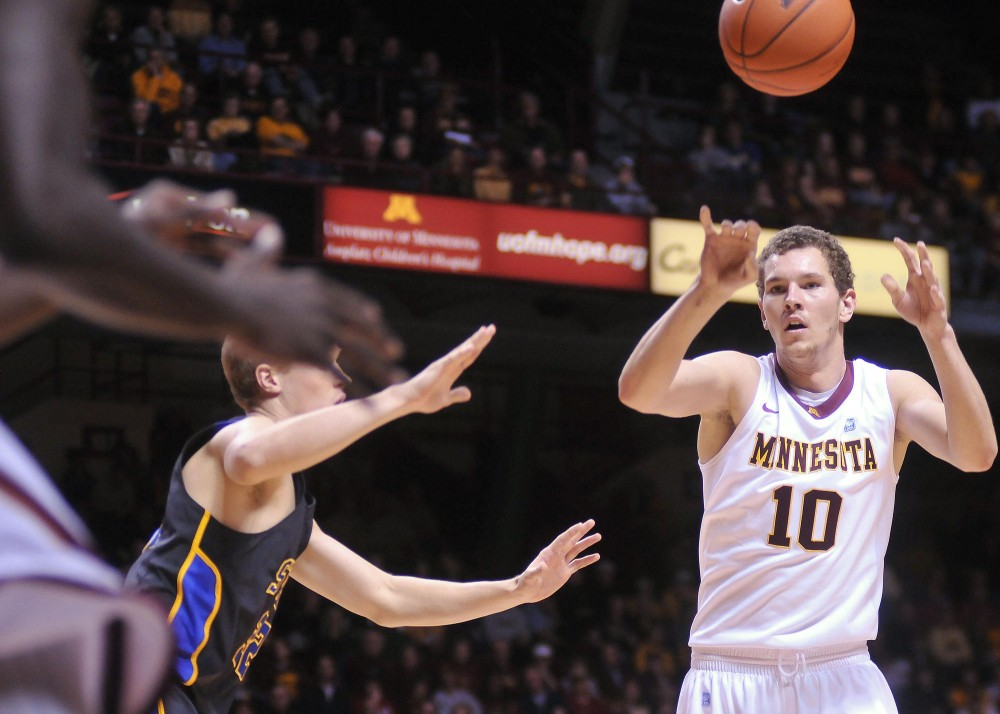 Oto Osenieks makes a pass Monday, November 14 in a game against South Dakota State at Williams Arena.  The redshirt freshman is expected to receive more playing time while Trevor Mbakwe misses the season with a torn ACL.