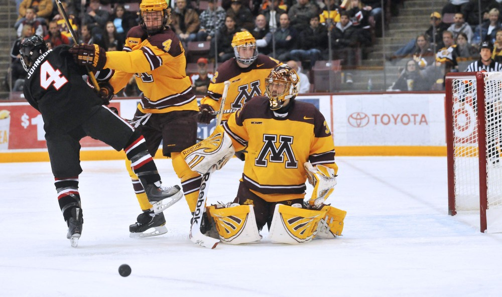 Kent Patterson deflecting a shot during Saturday's game against SCSU in Mariucci Arena.  Patterson set a new Minnesota record with his sixth shutout of the season breaking Robb Stauber's record established in 1987-88.