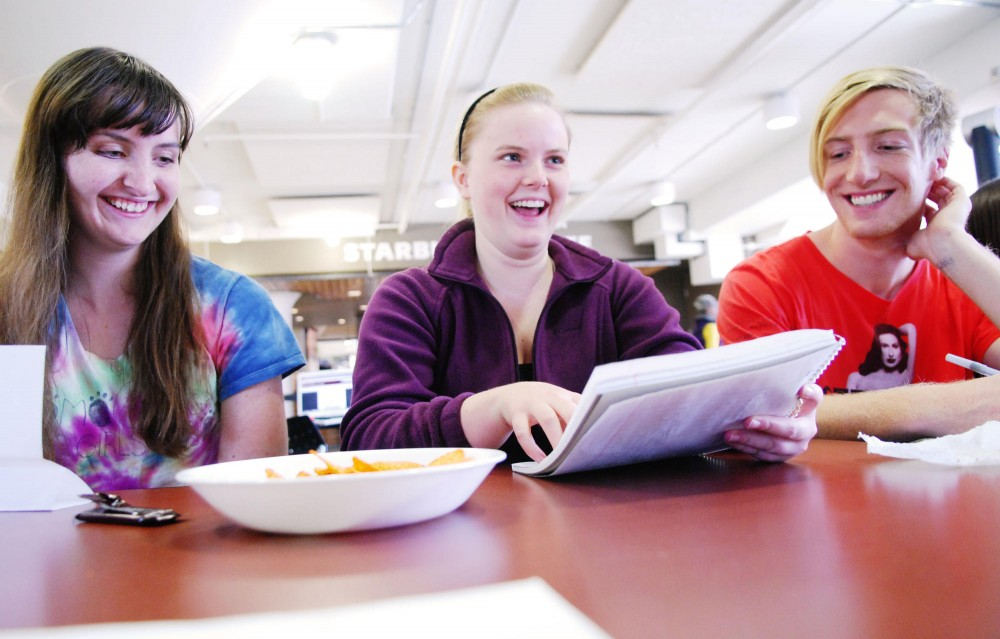 From left to right; freshman Laura Burnes, freshman Katie Krueger and junior Alex Lauer discuss ideas for novels Saturday during the National Novel Writing Month student group's introductory meeting at Coffman Memorial Union.