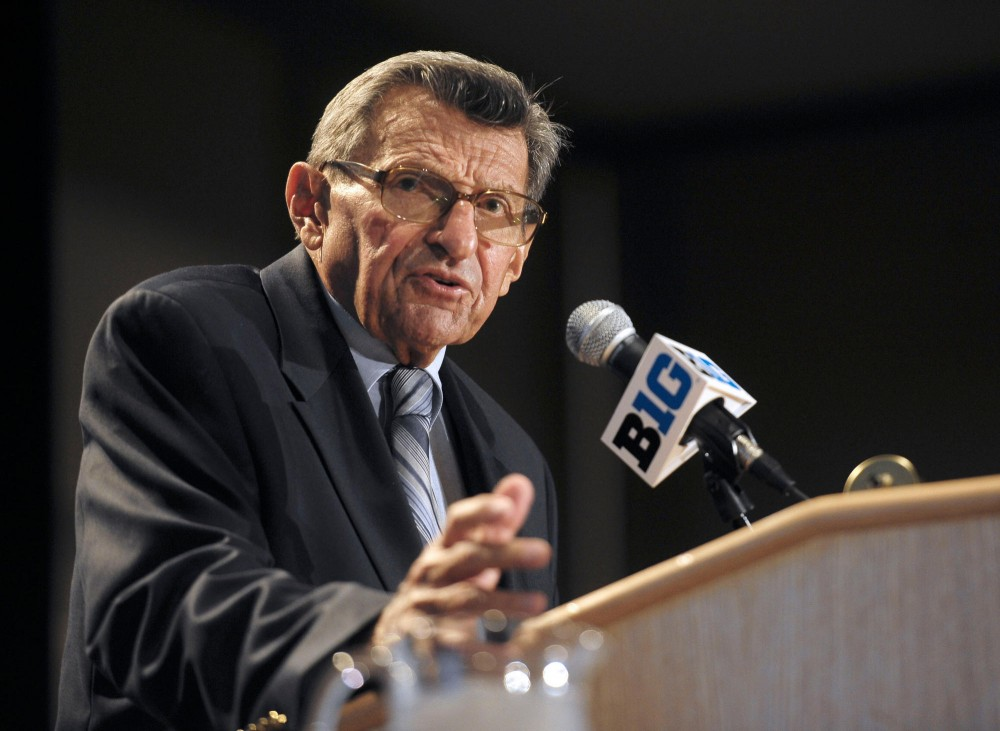 Penn State Head Coach Joe Paterno talks with reporters July 28 at Big Ten Media Days in Chicago.