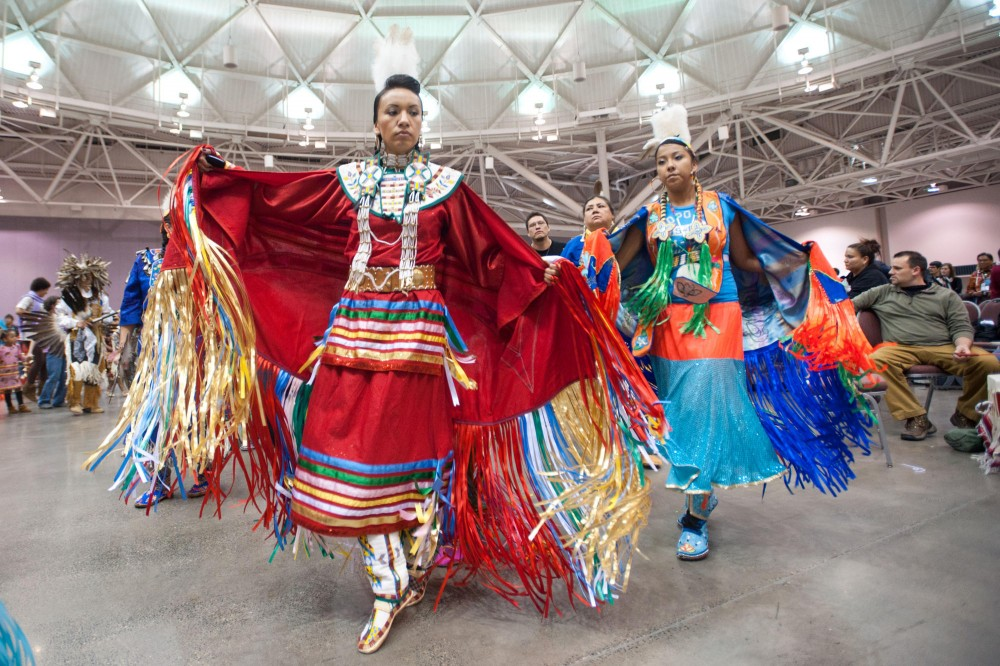 Kinesiology graduate student Tanksi Clairmont  dances during a Pow Wow Saturday in Minneapolis convention center.