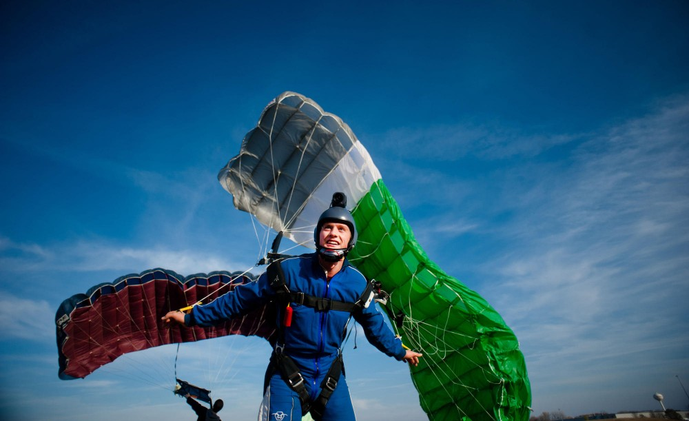 Mechanical engineering graduate student Johan Kolstoe Soenstaboe deploys his parachute into the wind while waiting for jumping conditions to improve over the drop zone Nov. 5 in Winsted, Minn.