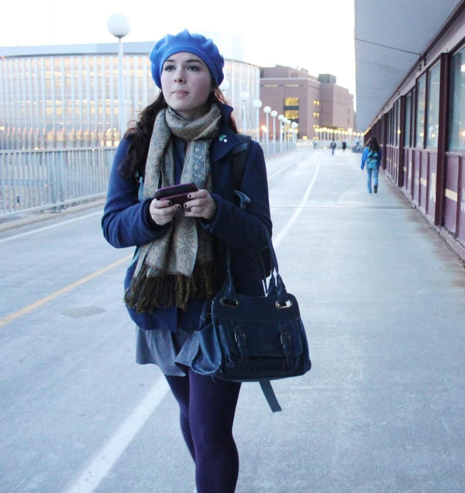 Freshman Julia Ennen walks across the Washington Ave. Bridge to her 8 am music class on West Bank early Thursday morning.