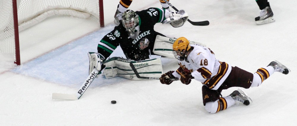 Minnesota Forward Nick Larson scores the game tying goal against University of North Dakota Saturday evening at the Mariucci Arena.