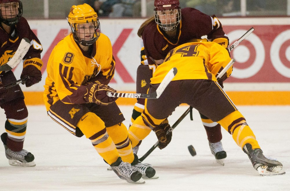 No. 8 Amanda Kessel keeps control of the puck Saturday at Ridder Arena in Minneapolis. The Gophers beat the Minnesota Duluth team Friday and Saturday nights.