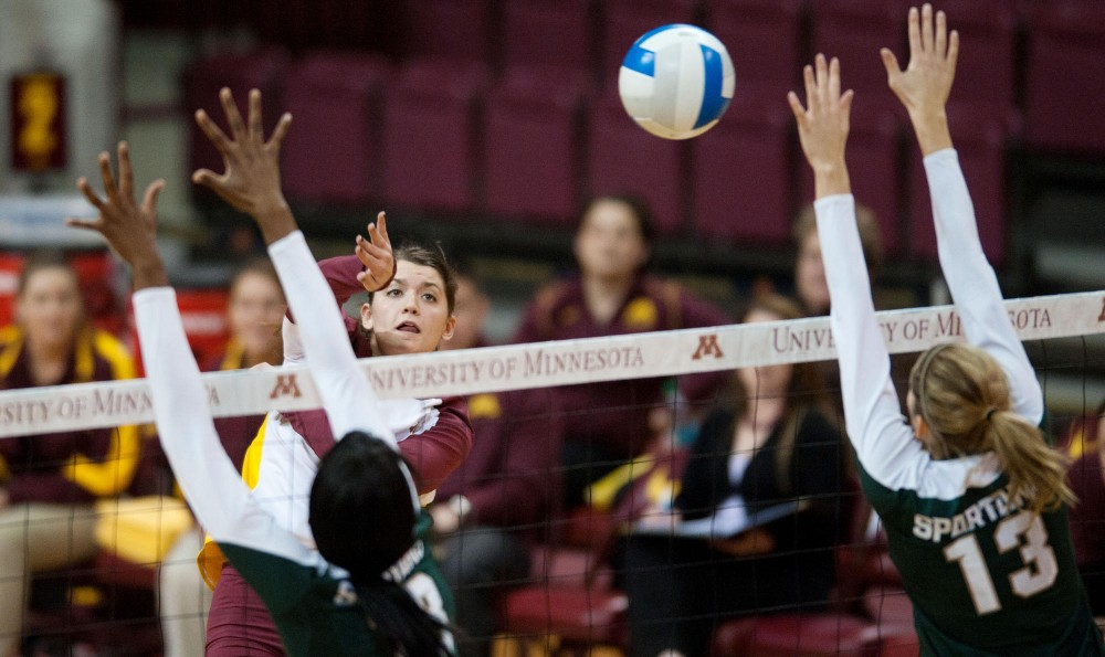 Gophers outside hitter Hailey Cowles hits against Michigan State's block on Wednesday at the Sports Pavilion.