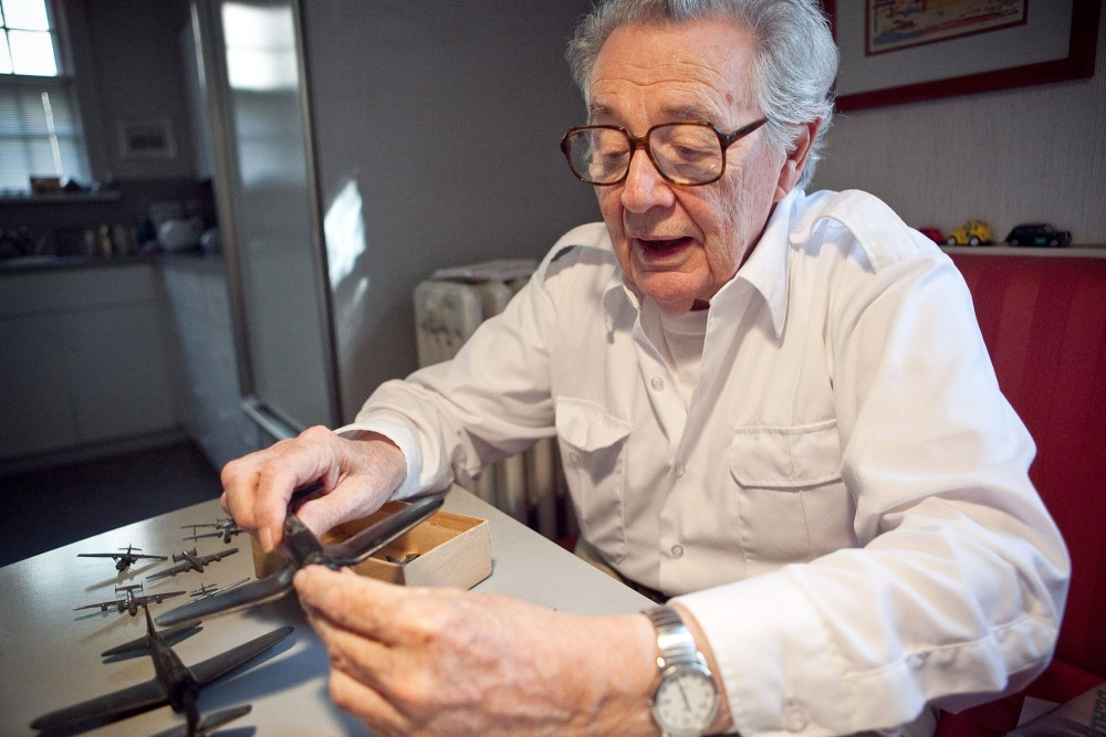 Professor John Hart shows the different model planes he used to teach other sailors with during World War II Saturday morning at his home in Edina. Planes like these helped sailors determine enemy planes from American.