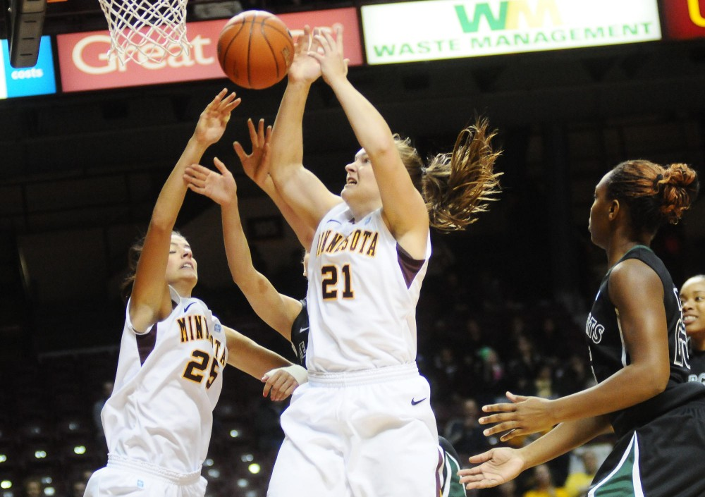 Minnesota forward Katie Loberg and guard Sari Noga defend against the Binghamton Bearcats  during the women's 2011 Subway Basketball Classic on Saturday at William's Arena. The Gophers defeated the Bearcats 65-40.