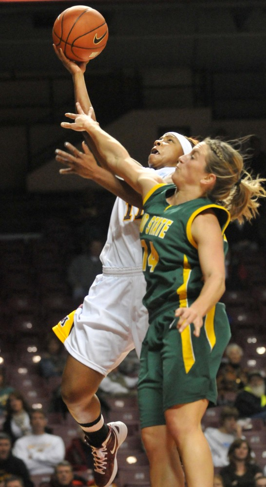 Junior Leah Cotton makes a layup Sunday, November 20 against NDSU at Williams Arena.