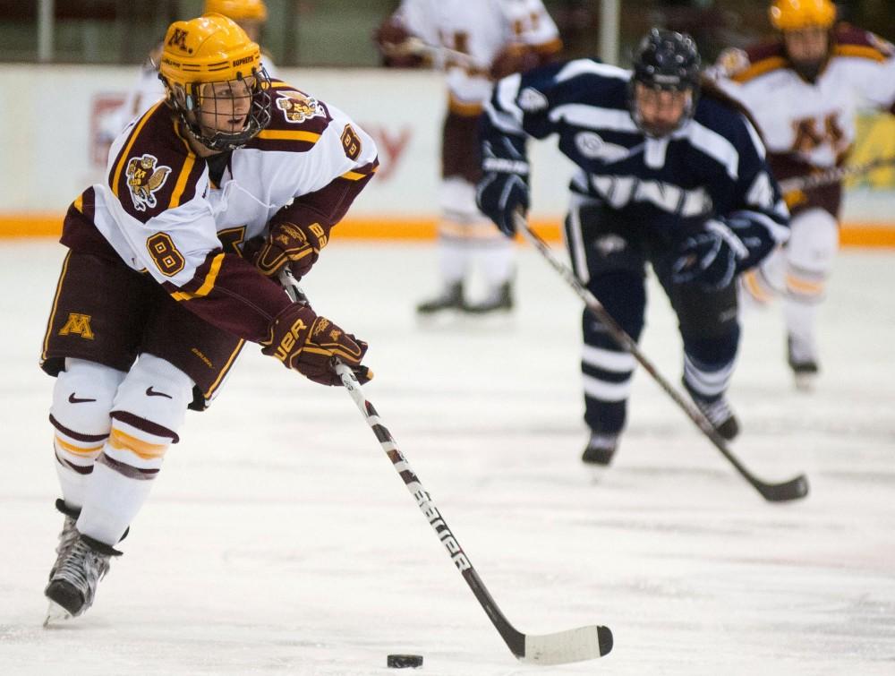 Gophers forward Amanda Kessel drives the puck toward the New Hampshire goal Friday at Ridder Arena.