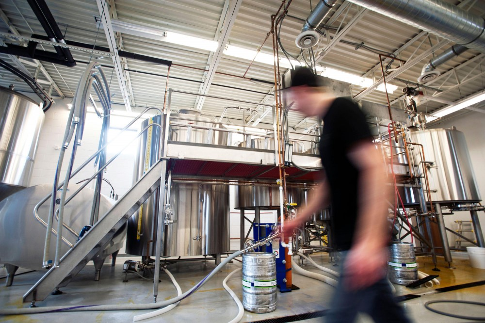 Fulton brewer Mike Salo works in the brewing room at Fulton Brewery Wednesday in the Downtown Warehouse District.