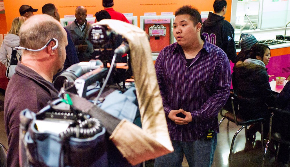 Kinesiology sophomore Yee Leng Vue is interviewed by KSTP at Chilly Billy's on Monday in Dinkytown.