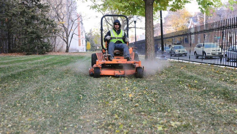 Allen OLeary mulched leaves in front of the Bell Museum of Natural History Monday in preparation for snowfall.