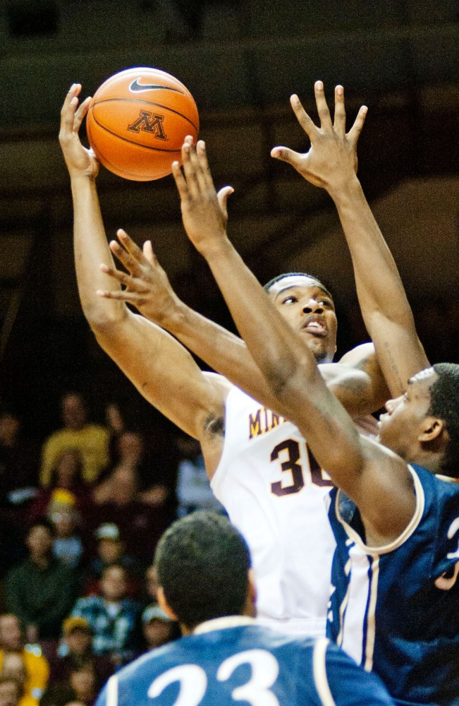 Gophers' forward Andre Ingram goes up for a shot during a game against Mount St. Marys on Monday at Williams Arena.