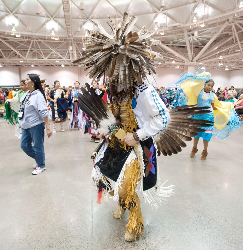 Head dancer Jacob Swaney leads a dance during a Pow Wow Saturday in Minneapolis Convention Center.