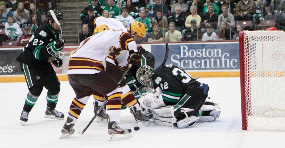 Freshman forward Kyle Rau scores the game winning goal with 45.8 seconds left in the game Saturday night in Mariucci Arena.