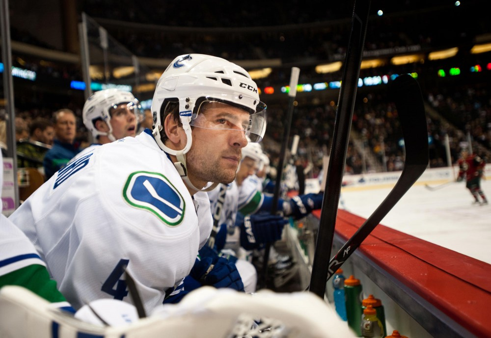 Vancouver Canucks' Keith Ballard sits on the bench during a NHL hockey game Thursday at Xcel Energy Center in St. Paul.  Ballard won two NCAA Championships in his three seasons with the Gophers.