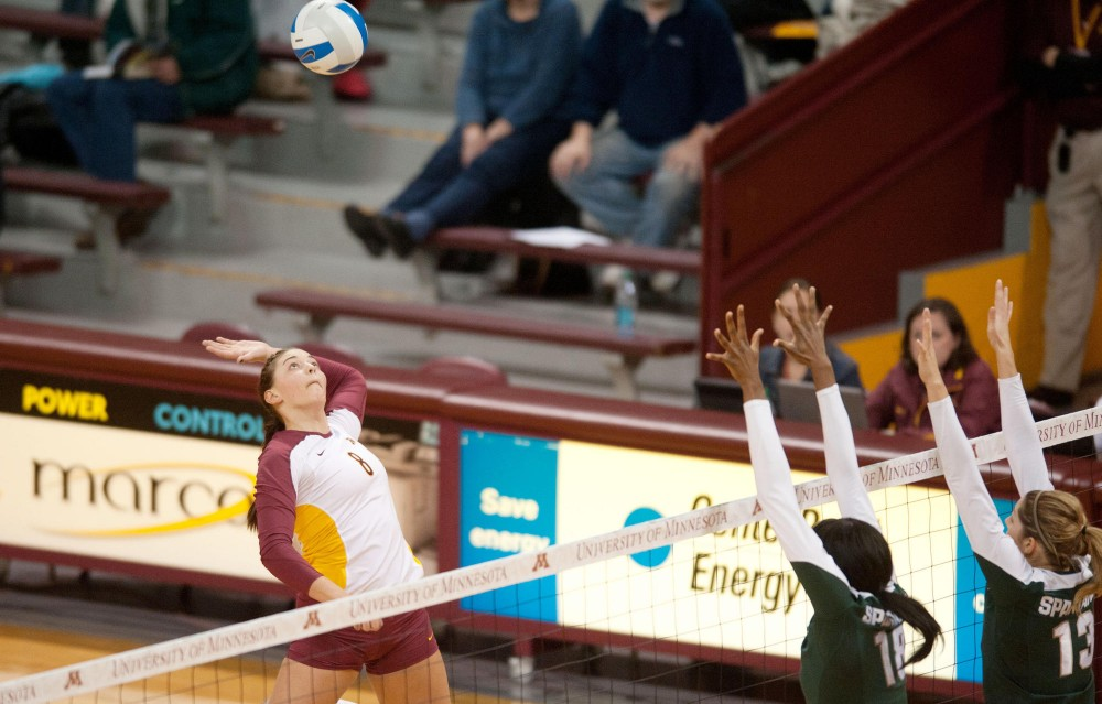 Gophers outside hitter Katherine Harms spikes the ball against Michigan State on Wednesday at the Sports Pavilion. Harms had 10 kills in Minnesota's 3-0 win.