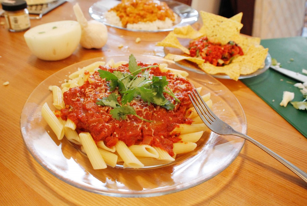 Homemade pasta sauce, salsa, and tomato curry over rice is a three-course meal that wont break a college students budget yet keep the stomach from grumbling in class.