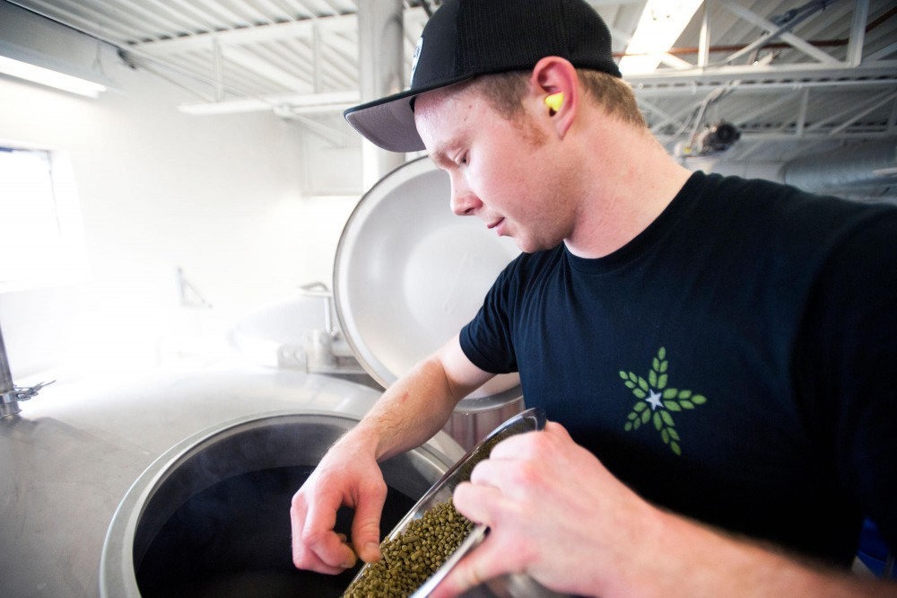 Fulton brewer Mike Salo adds hops in a whirlpool at Fulton Brewery Wednesday in the Downtown Warehouse District.