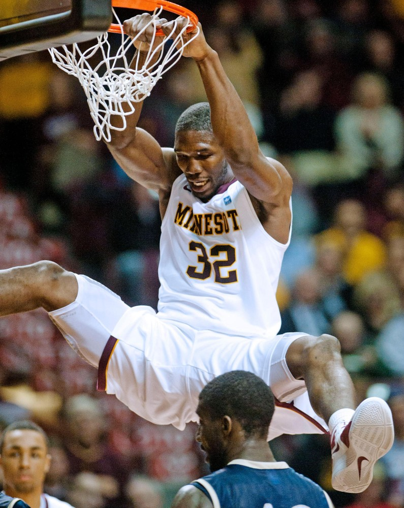 Gophers' forward Trevor Mbakwe dunks during a game against Mount St. Marys on Monday at Williams Arena.