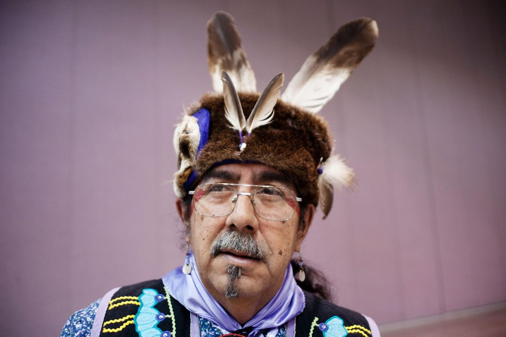 Robert Desjarlait from Red Lake Nation Bear Clan poses for a portrait Saturday at Minneapolis Convention Center. Desjarlait is wearing a otter skin turban.
