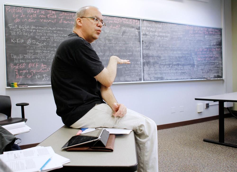 Professor Gilbert Rodman summarizes ideas following a class exercise Thursday in Ford Hall.