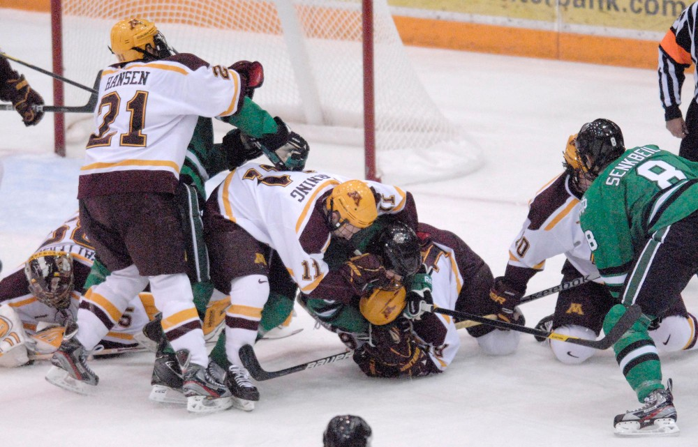 Chaos ensues in front of the Minnesota net during Friday's game against University of North Dakota at Mariucci Arena.  Friday night 69 penalties were dispersed but the Gophers managed a 2-0 victory.