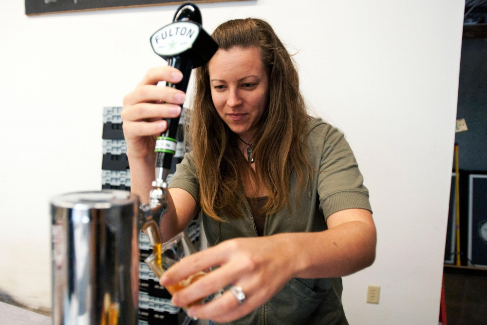 Katie Hoffman pours a sample of Sweet Child of Vine, Fulton's India Pale Ale at Fulton Brewery Wednesday in the Downtown Warehouse District.