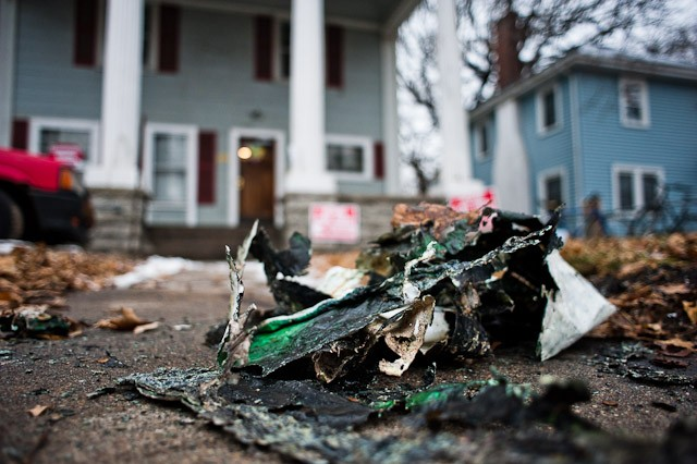 Charred paper rests on the lawn of a house on the 1000 block of Fourth Street Southeast that a man tried to light on fire earlier Saturday afternoon.