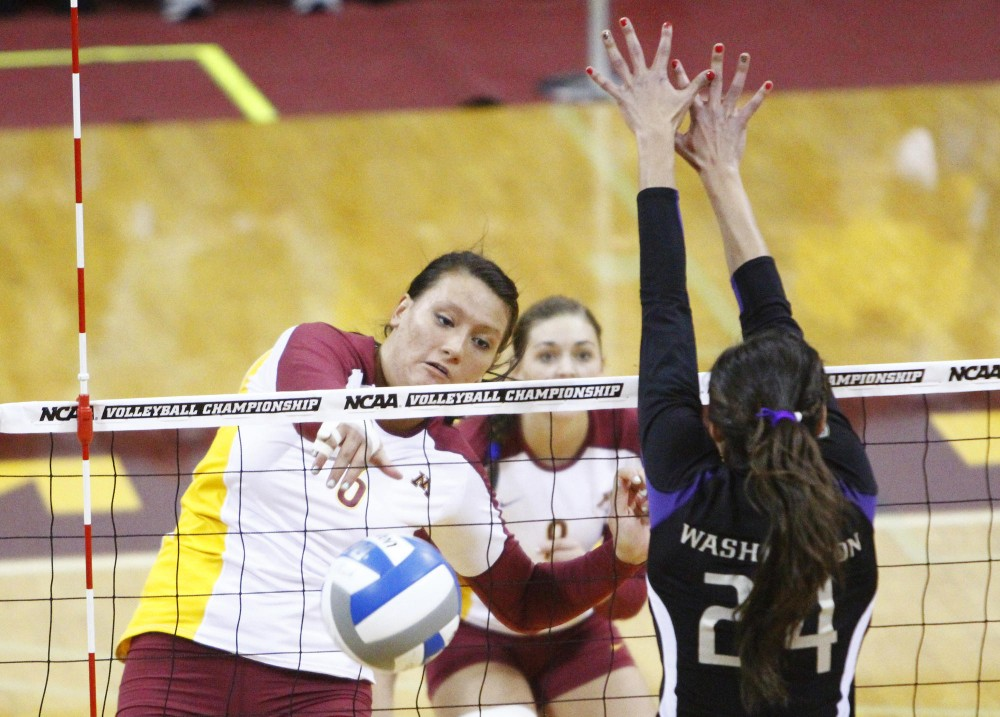 Middle blocker Tori Dixon drives the ball past Washington Saturday at the Sports Pavilion. Minnesota beat Washington in five sets and will advance to the NCAA regionals.