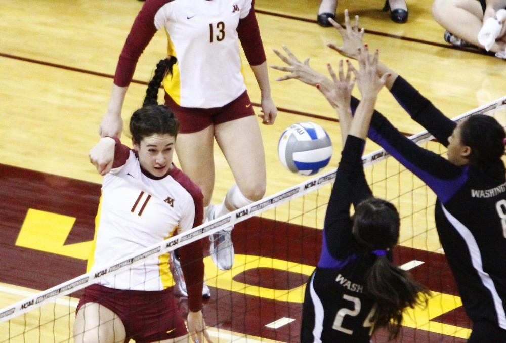 Minnesota middle blocker Ariana Filho drives the ball against Washington Saturday at the Sports Pavilion.