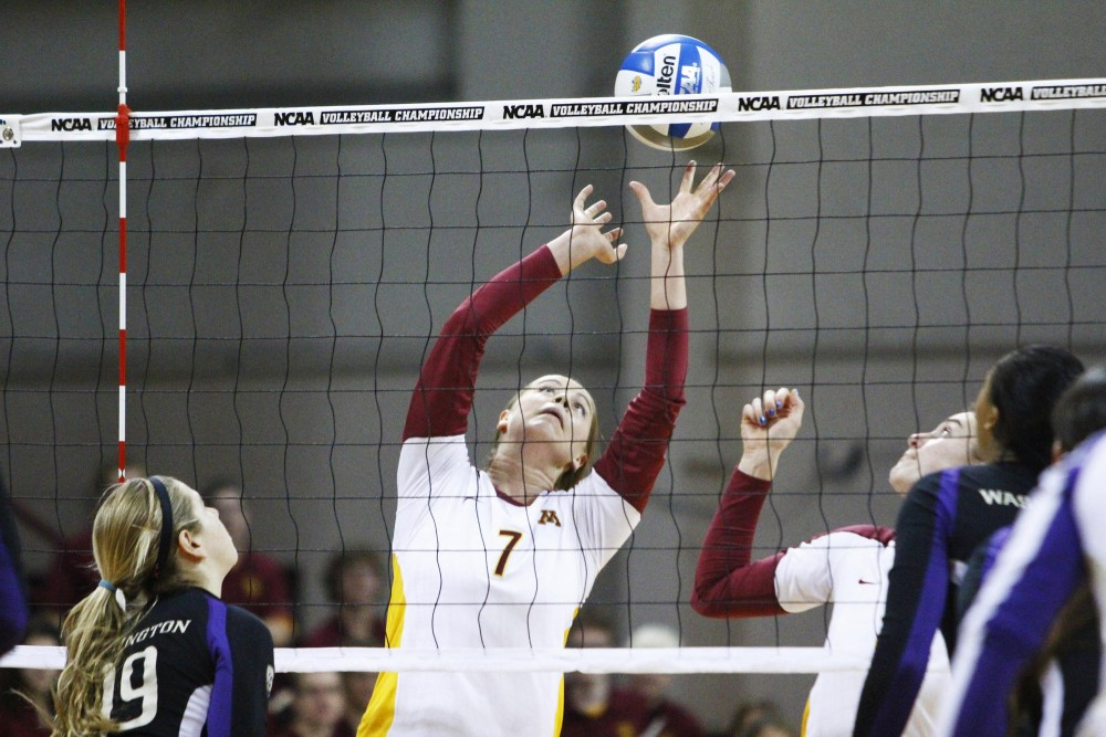 Minnesota setter Mia Tabberson readies the ball for an attack against Minnesota Saturday at the Sports Pavilion. Minnesota beat Washington in five sets and will advance to the NCAA regionals.