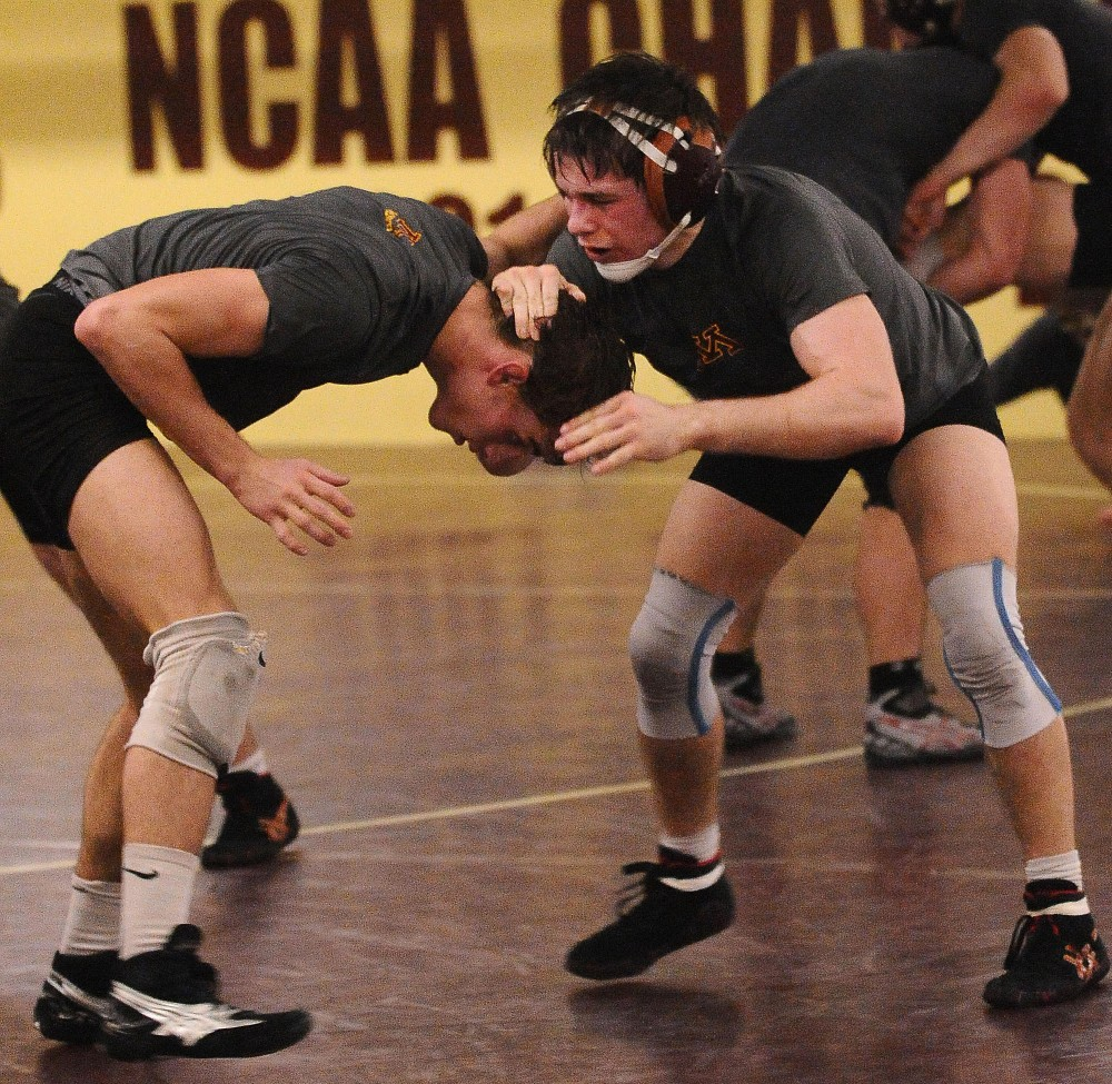 Freshman Chris Dardanes, right, wrestles Sophomore David Thorn during practice Tuesday at Bierman.  Dardanes and his twin brother, Nick, are currently in their second season on the team.