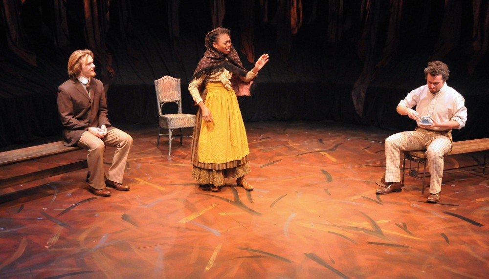 Seniors Torsten Johnson, left, ShaVunda Horsley, center, and Alex Brightwell rehearse a scene Tuesday night at Rarig Center in preparation for an upcoming play called Uncle Vanya.  The play is one of two Chekhov plays being performed by University of Minnesota BFA students.