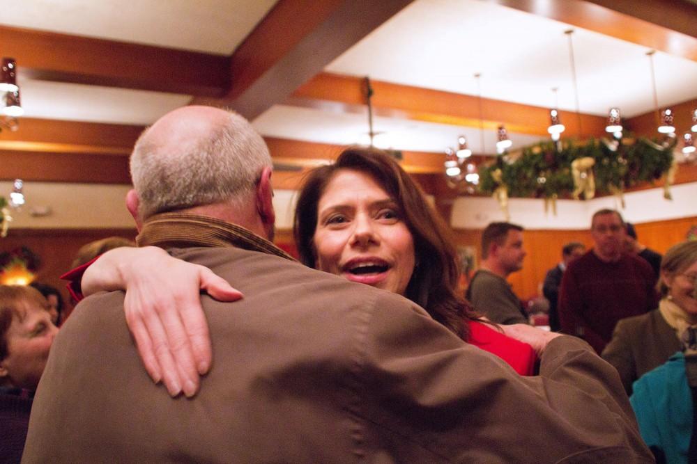 DFL primary winner Kari Dziedzic celebrates her victory Tuesday night  at Jax Cafe in Minneapolis.