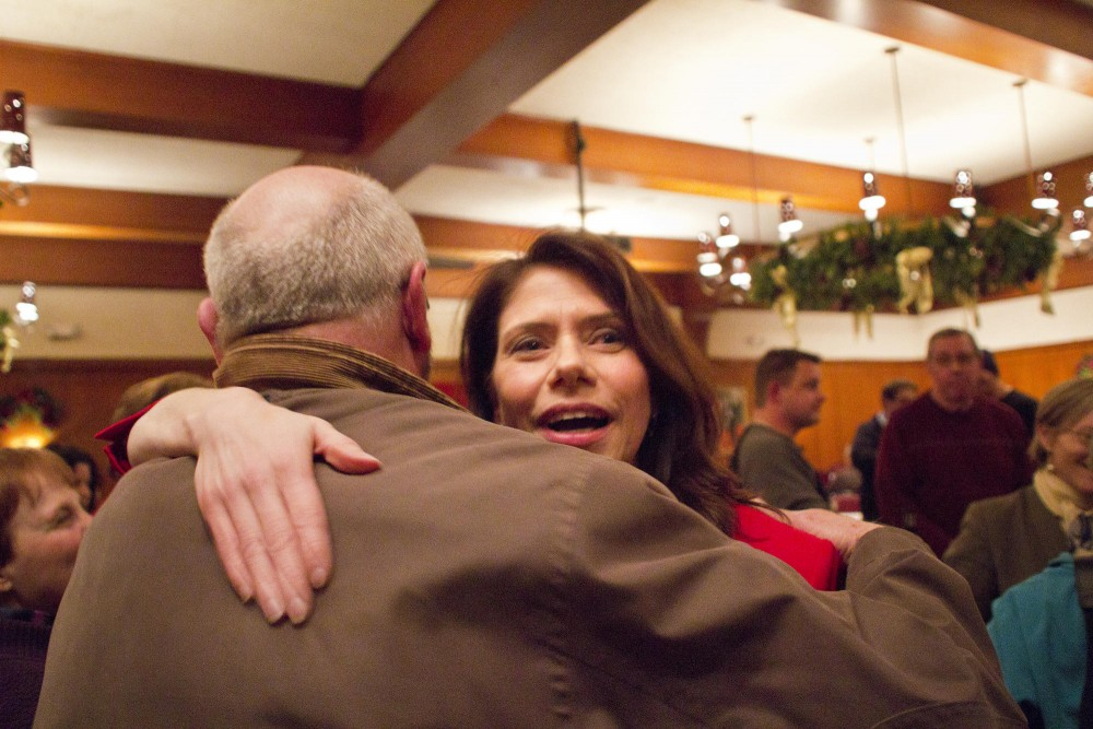 DFL primary winner Kari Dziedzic celebrates her victory Tuesday night  at Jax Cafe in Minneapolis with friends and supporters. Dziedzic won with 32 percent of the vote.