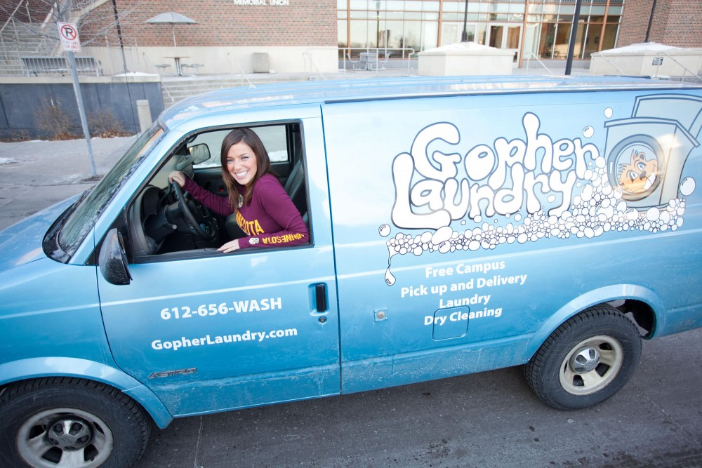 CEO of Gopher Laundry Masha Kushnir poses for a photo in the new Gopher Laundry van outside of Coffman Saturday afternoon.