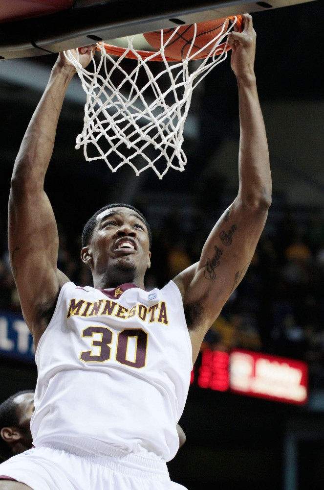 Forward Andre Ingram dunks the ball in Wednesday nights game against Virginia Tech at Williams Arena.
