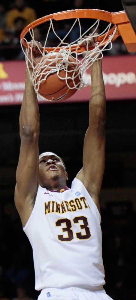 Junior forward Rodney Williams dunks in the first half against Appalachian State Tuesday at Williams Arena.