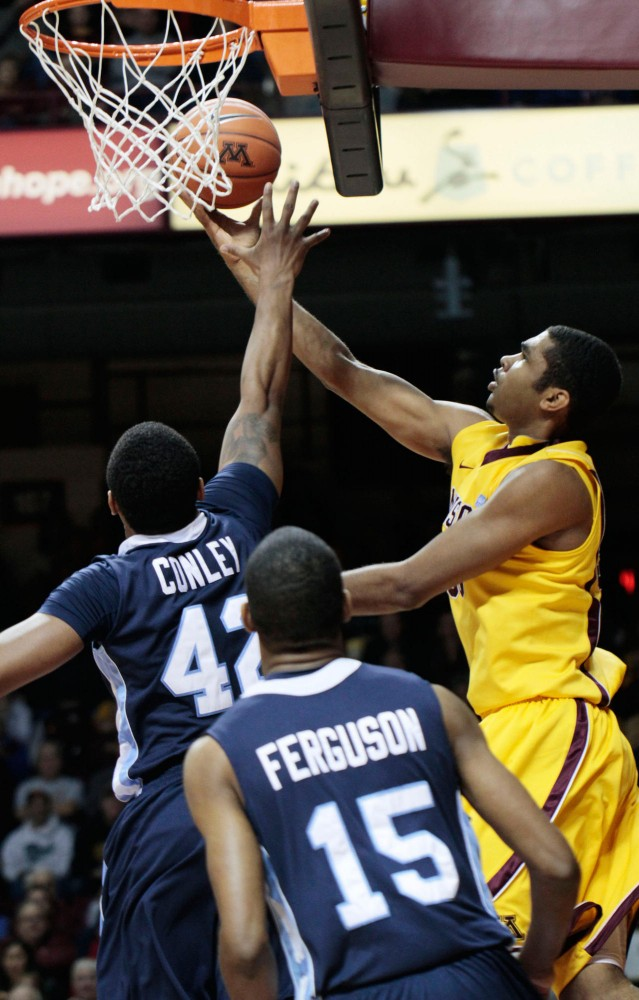 Minnesota forward Ralph Sampson III makes a reverse layup against St. Peter on Saturday at Williams Arena.  Sampson had his best game of the season with 15 points, eight rebounds and four blocked shots.
