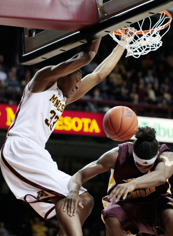 Forward Rodney Williams dunks the ball in the game against Central Michigan on Tuesday night at Williams Arena.