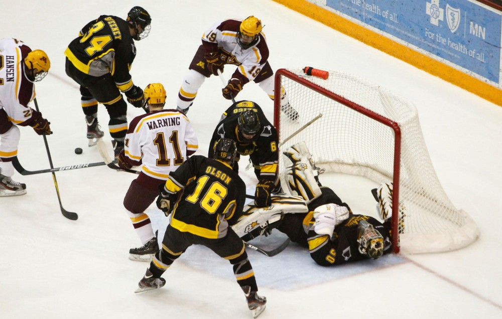 Chaos ensues in front of Michigan Tech's net during Friday's game at Mariucci Arena.  Saturday's contest chippy throughout the game.
