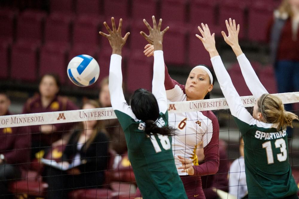 Minnesota middle blocker Tori Dixon spikes against Michigan State Nov. 9 at the Sports Pavilion.